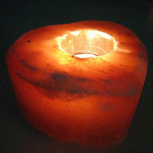 Подсвечник соляной Сердце, ионизатор воздуха, солевой светильник, ночник для снаСоляные лампы-подсвечники<br>Подсвечник соляной Сердце<br><br>Солевой подсвечник Сердце, состоит из кристалла природной соли изготовленного вручную. Внутри него размещается маленькая свеча на металлической подставке. Если свечу зажечь она будет нагревать и освещать окружающий ее кристалл. Благодаря нагреву в комнате увеличивается количество отрицательных ионов, улучшающих самочувствие человека. Внутренний узор, образуемый слоями породы, уникален для каждого подсвечника, а цвет зависит от шахты, из которой добыта каменная соль: красный, желтый, белый и их оттенки и переливы.<br> <br> <br> <br>Романтический вечер, украшенный мягким свечением подсвечника, станет незабываемым и приятным. мерцающий свет, пробивающийся сквозь натуральный кристаллы соли подсвечника, озаряет причудливым мягким светом пространство, не раздражая глаза. Источником света в солевом подсвечнике Сердце является обычная свеча, поэтому подсвечник распространяет вокруг себя естественный мягкий свет.<br> <br>Можно также использовать ароматизированную свечу, и тогда подсвечник создаст в комнате неповторимую атмосферу вашего любимого аромата.<br><br>Размер: 10.9х10.9х10.1 см<br>