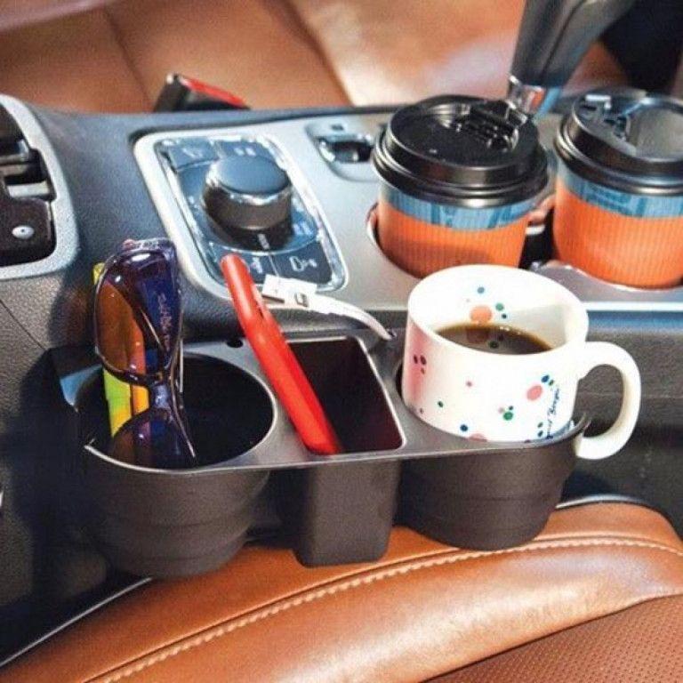 Подставка для кружек в автомобиль Bradex (Брадекс)Товары для автомобиля<br>Подставка для кружек в автомобиль Bradex<br> <br> <br>  <br> <br> <br>В дальней дороге велика вероятность, что кто-нибудь прольет напиток на кресло из-за отсутствия свободных подстаканников. Подставка для кружек в автомобиль – простой органайзер, способный уберечь салон Вашей машины от разлитого и разбрызганного кофе, чая, сока.<br> <br>Подставка для кружек в автомобиль Bradex надежно фиксирует напитки и уберегает салон от пятен и разводов. Имеет 2 подстаканника и полку для мелочей. Не требует сложной установки. Занимает неэффективное пространство между сиденьем и консолью.<br> <br> <br>  <br> <br> <br>- Подставка сделана из прочного пластика, легко снимается и устанавливается<br> <br>- Держатель для кружек легко впишется в любой в интерьер, не мешает водителю и пассажирам<br> <br> <br>  <br> Характеристики:<br> <br>Материал: abs-пластик<br> <br>Лицевая сторона: 280х100 мм<br> <br>Диаметр отверстия для кружки: 90 мм<br> <br>Глубина отверстия: 60 мм<br> <br> <br>  <br> <br> <br>Для оптовых покупателей:<br> <br>Чтобы купить подставку для кружек в автомобиль оптом, необходимо связаться с нашими операторами по телефонам, указанным на сайте. Вы сможете получить значительную скидку от розничной цены в зависимости от объема заказа.<br> <br>Для получения информации о покупке товаров посетите разделОптовых продаж<br> <br> <br>  <br> <br> <br> <br>  <br> <br>