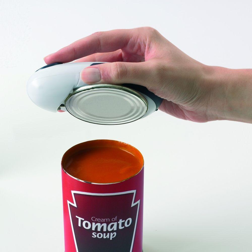 Электрический консервный нож One Touch Can Opener (Ван Тач)Ножи<br>Электрический консервный нож One Touch Can Opener (Ван Тач)<br> <br> <br>  <br> <br> <br>Открывалка One Touch снабжена специальным магнитным фиксатором, удерживающим ее на банке, тем самым пока открывается консервная банка, можно заниматься другими делами!<br> <br> <br>  <br> <br> <br>Как пользоваться, как открывать консервным ножом?<br> <br>Управление достаточно простое и интуитивное. Ведь достаточно установив нож на банку нажать на кнопку, как автоматическая открывалка самостоятельно проделает всю необходимую работу.<br> <br> <br>  <br> <br> <br>Преимущества использования One Touch Can Openen<br> <br>Предыдущие модели электрических консервных ножей были достаточно громоздкими, занимали в кухонном шкафу лишнее место. Зато с появлением открывалки Ван Тач в вопросе как открыть ножом консервную банку многое изменилось!<br> <br>Прежде всего - это маленькая, компактная модель, которая легко помещается в ящике кухонного стола, но самое привлекательное в том, что банки можно открывать даже при отсутствии электричества. Энергии батареек в среднем хватает для открытия 100 банок. А экономия драгоценного времени? Ведь самостоятельно проделывая за вас всю основную работу, удержание ножа осуществляется встроенным магнитным фиксатором, автоматическая открывалка позволяет заниматься другими делами.<br> <br> <br>  <br> <br> <br>Технология открывания:<br> <br>Консервный электрический нож с колесиком спроектирован так, что может резать одновременно с двух сторон настолько нежно, осторожно, что в еду никогда не попадут кусочки железа! Если необходимо банку с остатками содержимого поместить в холодильник, то ее можно будет обратно закрыть крышкой.<br> <br> <br>  <br> <br><br><br>  <br><br><br><br>  <br><br> <br>Особенности:<br> <br> <br>   <br>    Отсутствие зазубрин, острых угло<br>   <br>    Процесс открывания автоматизирован<br>   <br>    Легко крепится/снимается<br>   <br>    Не требуется удерживать банку<br>   <br