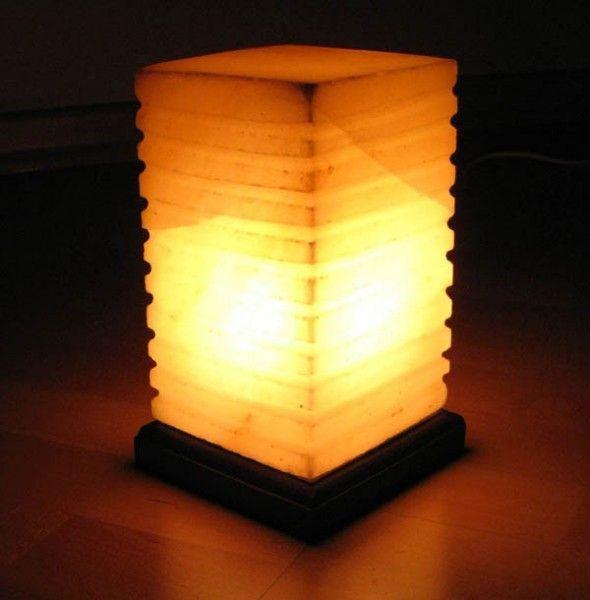 Соляная лампа Пятый Элемент, ионизатор воздуха, Солевой светильникСоляные лампы в форме куба<br>Соляная (Солевая) лампа Пятый Элемент<br> <br>Соляная лампа Пятый Элемент весит в районе 4-5 кг. Светильник таких габаритов подойдет для комнаты площадью около 18 квадратных метров. Лучше всего ее поместить в слабо освещенный район помещения, где чувствуется нехватка свежести и энергии. Мужчины и женщины, дети и взрослые, все получат сплошную выгоду для своего здоровья – достаточно включать время от времени соляной светильник, когда Вы хотите просто прилечь и отдохнуть. <br>  <br> Плафон декоративного ночника-ионизатора Пятый Элемент выполнен из куска гималайского галита (каменной соли) возрастом 500 млн лет. Ионизация воздуха происходит совершенно натуральным путем, бесшумно, без посторонних запахов. Электрическая лампочка нагревает солевые кристаллы, и в воздух начинают выделяться отрицательные ионы, которые компенсируют вред от излучения различных бытовых приборов, и самое главное - атмосфера в доме приобретает свежесть морского побережья или высокогорного плато. Вдыхая обработанный соляной лампой воздух, Вы почувствуете себя значительно лучше.<br> <br>Приобрести не просто известный своими многочисленными целебными свойствами предмет. Купить соляную лампу можно не только в качестве украшения, но и для лечения многих заболеваний, и просто для создания обстановки спокойствия в доме, и для поднятия жизненного тонуса всех проживающих в нем членов семьи. <br>  <br> <br>  <br> Не стоит откладывать покупку – что может быть важнее для гармонии в доме, чем здоровье близких людей и свежая атмосфера. Соляная лампа WONDERLIFE исцеляет тело, облагораживает атмосферу и дает бодрость духу.<br> <br>Основные особенности соляной лампы Пятый Элемент<br> <br>Форма: фигурный кубический столб<br> <br>Цвет: желтое пламя<br> <br>Вес: около 4,5 кг<br> <br>Подставка: дерево<br> <br>Комплектация<br> <br>1. Соляная лампа Пятый элемент<br> <br>2. Сетевой шнур 220В<br> <br>3. Упаковка - картонная к