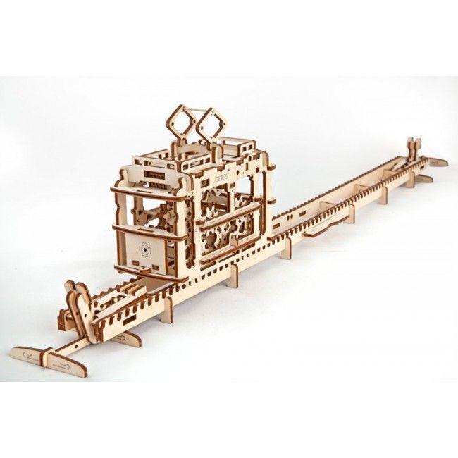 Деревянный конструктор (3D пазл) UGEARS - Трамвай с рельсамиДеревянный конструктор Ugears<br>Деревянный конструктор (3D пазл) UGEARS - Трамвай с рельсами<br> <br><br>  <br><br><br><br>   <br> <br> <br> <br>   <br>     <br>       <br>         <br>          Трамвай с рельсами - механический пазл-конструктор для любителей самостоятельного моделирования. 3D пазл Трамвай – изящная, многофункциональная механическая модель, до мельчайших подробностей воспроизводящая реальный старинный городской трамвай. Деревянный конструкто Трамвай с рельсами это большая, многоэлементная модель, которая в собранном виде конструкция состоит из самого трамвая и рельсов, по которым он ходит. Эта модель может работать не только от традиционного резинового двигателя, но и как инерционный фуникулер.<br>        <br>      <br>    <br>  <br><br><br>  <br>    <br>      <br>        <br>          <br>            <br>              <br>            <br>          <br>        <br>      <br>    <br>  <br><br><br>  <br>    <br>      <br>        <br>          Что из себя представляет?<br>        <br>          Объемный пазл Трамвай первоначально представляет собой четыре плоские фанерные дощечки, в которых с помощью компьютеризированного лазерного станка вырезаны детали модели. Все детали пронумерованы. Перед началом сборки, элементы конструкции следует извлечь из дощечки-основания, просто выщелкнув их. Производители рекомендуют надсечь острым ножом удерживающие детали перемычки, чтобы они легче вынимались из заготовки. Деревянный конструктор Трамвай с рельсами, игрушка достаточно сложная, для ее сборки ребенку, наверняка, понадобится помощь взрослых.<br>        <br>          <br>            <br>          <br>         <br>       <br>     <br>   <br> <br>  Характеристики:<br> <br>  Материал: фанера<br> <br>  Размеры модели: 157х122х136 мм<br> <br>  Количество деталей: 154<br> <br>   <br>    <br>   <br> <br>  Для оптовых покупателей:<br> <br>  Чтобы купить деревянный конструктор Трамвай с рельсами оптом, необхо