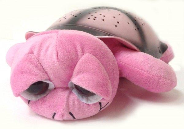 Ночник проектор звездного неба Музыкальная черепаха Music Turtle Pink розовая, детский светильник для детей в спальнюНочники проекторы звездного неба Черепаха<br><br> Хотите узнать дешевый и надежный способ быстро успокоить детвору перед сном? Тогда вы обратились по адресу. Достаточно приобрести проектор «Music Turtle» и проблема укладывания ребенка в кровать исчезнет раз и навсегда. Вам больше не придется часами петь колыбельные или оставлять включенным свет в комнате. «Music Turtle» сделает все за вас.<br><br><br> «Мьюзик Тартл» — это настоящее чудо. Она не только порадует глаз в темное время суток, но и станет настоящим другом вашего малыша. Только представьте: каждый вечер в детскую приходит удивительное волшебство. Стоит лишь погасить свет и скучный белый потолок превращается в чудесное звездное небо, звучит мягкая чарующая мелодия. Правда, здорово?<br><br><br>  <br><br>Описание<br><br> Если вы все еще сомневаетесь обязательно изучите отзывы тех, кто уже приобрел это чудо. Ночник обязательно станет любимой игрушкой вашего ребенка. Кроме того, это недорогой способ создать романтическую обстановку для родителей. Мягкий рассеянный свет и нежная мелодия подарят много приятных минут.<br><br><br> Ночник имеет несколько режимов работы и немного напоминает классическую елочную гирлянду, только более современную и не такую яркую. Устройство позволяет самостоятельно выбрать цвет звездочек, мелодию и режим смены изображения.<br><br><br> Ребенок может сам установить те параметры, которые больше нравятся:<br><br><br>Чередующееся изображение звезд каждого оттенка.<br>Одновременная проекция 2 цветов во всех вероятных комбинациях.<br>Постоянное отображение всех имеющихся цветов.<br>Медленное мерцание звезд 1 оттенка.<br><br><br> Кроме того, можно выбрать мелодию или настроить их чередование. Если звук проектора мешает ребенку заснуть, его можно просто отключить. Управление осуществляется большими кнопками и интуитивно понятно.<br><br><br>  <br><br>Преимущества<br><br>Одновреме