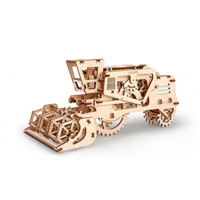 Деревянный конструктор UGEARS Комбайн, (3D пазл), для детей, для взрослых, для конструированияДеревянный конструктор Ugears<br>Деревянный конструктор (3D пазл) UGEARS - Комбайн<br> <br> <br>  <br> <br> <br> <br>   <br> <br> <br> <br>   <br>     <br>       <br>         <br>          <br>            Деревянный конструктор Комбайн уверенно движется по горизонтальной поверхности благодаря оригинальному натяжному резиномотору. Объемная механическая модель имеет потайной ящичек, в котором можно хранить небольшие предметы. Секретный бокс открывается с помощью специального рычага. Модель предназначена для сборки своими руками и не требует ни клея, ни специальных инструментов.<br>          <br>            <br>              <br>            <br>          <br>            Элементы конструкции размещены на плоском фанерном основании. За счет использования метода компьютеризированной лазерной резки, все составляющие механической конструкции легко вынимаются из основания. Производитель рекомендует выщелкивать детали, слегка надавливая на них с изнаночной стороны. Прилагаемая к 3D пазлу Комбайн UGears инструкция содержит подробное описание процесса сборки механической деревянной модели.<br>          <br>            <br>              <br>            <br>          <br>            Готовая конструкция выглядит красиво и ажурно, напоминая дорогой сувенир, и одновременно является достаточно функциональной, чтобы с нею можно было играть. В процессе движения Комбайна сквозь резные боковые стенки конструкции отлично видна сложная система зубатых колес.<br>          <br>        <br>      <br>    <br>  <br><br><br><br>  <br><br><br> <br> <br> <br>   <br>     <br>       <br>         <br>           <br>            <br>           <br>         <br>       <br>     <br>   <br> <br>  Характеристики:<br> <br>  Материал: фанера<br> <br>  Размеры модели: 135х165х278 мм<br> <br>  Количество деталей: 154<br> <br>   <br>    <br>   <br> <br>  Для оптовых покупателей:<br> <br>  Чтобы купить деревянный констр