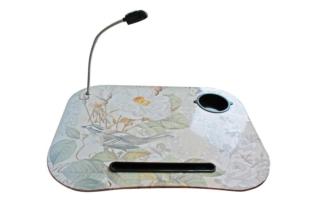 Мягкий столик для ноутбука, планшета E-Pad LapTopDesk, LDTop (model: D -4900), для пикника, для отдыхаСтолики для ноутбука<br>Мягкий столик для ноутбука, планшета E-Pad LapTopDesk, LDTop (model: D -4900)<br> <br>Электронные девайсы стали нашими постоянными спутниками – на работе и во время отпуска, в офисе, дома, во время путешествия – эта техника всегда с нами. Мы читаем новости и книги, смотрим фильмы и ролики, слушаем музыку, играем в игры, работаем с документами. Часто нам приходиться принимать неудобные позы, чтобы не расставаться с ноутом – просиживать часы напролет за столом или держать тяжелый ноутбук на коленях, рискуя уронить его на пол. Как пользоваться ноутбуком или планшетом с максимальным комфортом? Ответ прост – достаточно купить мягкий столик для ноутбука и планшета E-Pad LapTopDesk D-4900 в интернет-магазине Дирокс по самой привлекательной цене. <br> <br>  <br> <br>В чем особенность мягкого столика E-Pad LapTopDesk?<br> <br>Недорогой E-Pad LapTopDesk – одна из новинок на отечественном рынке, но этот столик уже становится очень популярным среди владельцев ноутбуков и планшетов. Почитайте отзывы – работать и коротать досуг за монитором ноутбука теперь намного удобнее. Мягкое приятное основание и плотное антискользящее верхнее покрытие, а также наличие светодиодного фонарика и подстаканника делают столик-подставку очень практичным и надежным помощником на работе и в быту. Фонарик работает от обычных батареек, оснащен гибкой ножкой и позволяет создать комфортное освещение монитора и клавиатуры ноутбука. А стакан с любимым напитком больше не угрожает вашему ноутбуку, ведь риск случайно пролить чай или кофе на клавиатуру сводится к нулю. Также, в поверхности столика предусмотрено отверстие для установки планшета – теперь вам не придется держать девайс в руках. Компактный формат, удобные ручки и маленький вес позволяют брать столик-подставку с собой в дорогу. Организовать рабочее место можно где угодно – дома, в машине, во время вылазки или в поездке. Устр