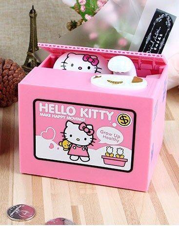 Копилка воришка в коробке Hello KittyКопилка воришка<br>Копилка Котик-воришка Hello Kitty.<br><br>         Копилка является одним из самых известных и распространенных сувениров. Однако, выбор их настолько велик, что удивить таким подарком не так-то просто. Представляем новинку среди копилок - кот-воришка.<br><br><br>         Многим известно, что коты любят прятаться и отдыхать в коробке. Если подумать, что может быть удобнее и уютнее небольшой коробочки? Ничего. Точно также думает и мурчащее создание, которого прячет в себе интерактивная копилка.<br><br>Преимущества:<br><br>запоминающийся подарок<br>интересный дизайн<br>изготовлен из безопасного материала<br>не надо разбивать, чтобы извлечь монеты.<br><br><br>         Копилка Кот Воришка в коробке – это милый и забавный подарок на любой возраст, который не оставит равнодушным ни ребенка, ни взрослого. На первый взгляд, копилка Хелло Китти в коробке представляет собой небольшую коробку с мисочкой, но стоит положить в миску монетки или нажать на неё, как коробка приоткрывается и оттуда выглядывает любимый персонаж, который забирает все монеты себе.<br><br><br>         Ни для кого не секрет, что все кошки любят прятаться и отдыхать в коробке. Если подумать, что может быть уютнее коробочки, в особенности картонной, да еще и маленькой... ничего! Точно также думает и усатое создание, которого прячет в себе интерактивная копилка. Но только стоит достать монетку из кармана, как начнется мини шоу, которое понравится и детям, и взрослым!<br><br><br> <br><br><br>         Копилка работает достаточно просто. Для начала необходимо не пожалеть любую монетку и положить ее на тарелочку копилки. Таинственный ящик сразу же приоткроется, и вы увидите круглые глазки, наблюдающие за новым предметом, которым вы решили поделиться. Котенок аккуратно высунет лапку и стащит монетку в свою уютную коробку в надежде, что вы не заметили – но так он думает зря! После этого он сразу спрячется. Самое интересное начнется потом - ведь таким способом 