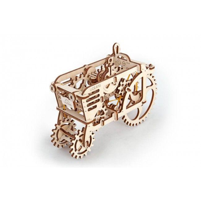 Деревянный конструктор UGEARS Трактор, (3D пазл), для детей, для взрослых, для конструированияДеревянный конструктор Ugears<br>Деревянный конструктор (3D пазл) UGEARS - Трактор<br> <br> <br>  <br> <br> <br> <br>   <br>    <br>      Трактор - самая популярная модель в линейке деревянных объемных пазлов. Конструктор претерпел несколько модернизаций. Сегодня купить деревянный конструктор Трактор можно в виде изящной действующей модели с двойным резиновым силовым агрегатом и обновленным дизайном.<br>    <br>      В конструкции не используется никакой электроники. Только деревянные элементы и обыкновенная резинка, именно она служит в готовой модели в качестве двигателя. Приятной особенностью является то, что с помощью резинодвигателя можно переключать передачи.<br>    <br>      <br>        <br>      <br>    <br>      Соберите своими руками<br>    <br>      Объемные пазлы – это удивительно увлекательная игрушка для взрослых и детей. Конструктор Трактор включает все необходимое для сборки объемной подвижной модели. Для монтажа конструкции не требуется ничего, кроме того, что есть в коробке и собственных рук. Инструкция 3D пазла Трактор выполнена в виде яркой цветной многостраничной брошюры.<br>    <br>      <br>        <br>      <br>    <br>      Особенности конструктора Трактор:<br>    <br>      - Готовая действующая модель полноприводная<br>    <br>      - Игрушка имеет три режима управления<br>    <br>      - Трактор может проехать на одном заводе около 80-100 см.<br>    <br>      Во время движения деревянный трактор издает звуки, напоминающие работающий двигатель. Внутри модели хорошо видно, как двигаются поршни.<br>    <br>      <br>        <br>      <br>    <br>      <br>        <br>      Трактор работает в трех режимах:<br>    <br>      Park – трактор заводится путем прокрутки большого колеса<br>    <br>      Drive – трактор медленно едет со скоростью приблизительно около 5 см в секунду<br>    <br>      Sport – трактор демонстрирует чудеса скорости и мчится на всех 
