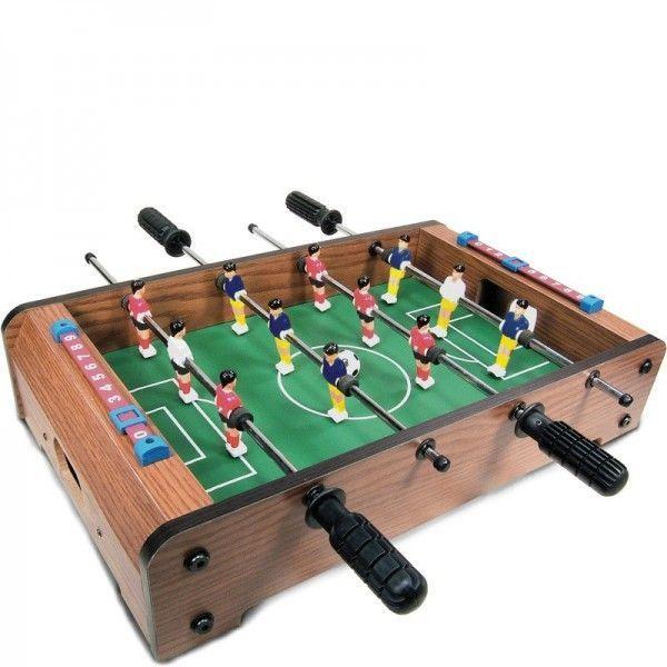 Настольный футбол TableTop Table Football D001 - 51x31x9.5см, игра для детейНастольный футбол<br>Настольный футбол TableTop Table Football D001<br> <br>Настольный футбол – это игра, объединяющая целые поколения! Вне всяких преувеличений, это – одно из самых популярных увлечений среди мальчиков и мужчин. У вас дома живет настоящий футбольный фанат, и вы хотите приятно удивить его отличным подарком? Или сами с удовольствием окунулись бы в жаркую футбольную баталию? Тогда спешите купить игровой стол TableTop Table Football в интернет-магазине Дирокс по самой низкой цене и играйте где и когда вам удобно. Устраивайте целые соревнования между друзьями или членами семьи, ведь настольный футбол – недорогой способ весело провести время и испытать целую гамму эмоций!<br> <br>  <br> <br>В чем уникальность этого игрового стола?<br> <br>Кикер или настольный футбол относится к разряду «домашних» игр. Но это – далеко не тихая и скучная забава! Это – настоящий вулкан азарта, хороший тренажер внимательности и ловкости и катализатор отличного настроения! Такой покупке обрадуется и ребенок, и взрослый.<br> <br>Мини-стол органично впишется в интерьер детской комнаты, не займет много места и в офисе. В последнее время такое развлечение очень популярно среди офисных сотрудников – это отличная возможность отвлечься, сбросить стресс и получить разрядку во время работы. Компактные размеры TableTop и небольшой вес позволят вам взять стол с собой на дачу или принести на вечеринку к друзьям. Детский настольный футбол – отличная альтернатива электронным гаджетам, особенно, если нет возможности погонять мячик во дворе. Как мы уже говорили, потребуется сконцентрировать все свое внимание на игровом процессе, проявить ловкость и научиться быстро реагировать – тогда победа вам обеспечена!<br> <br>  <br> <br>Преимущества покупки TableTop Table Football на Дирокс<br> <br> <br>  Компактные размеры игрового стола;<br> <br>  При необходимости стол можно легко и быстро разобрать или собрать;<br> <br>  При