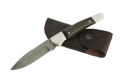 Нож Ворсма складной Снайпер, дамасская сталь, дерево-венге (кузница Семина)Товары для туристов<br><br> Гибкий, упругий, но при этом невероятно прочный нож – «Снайпер» не оставит никого равнодушным. <br><br><br> Если вы хотите получить надежный инструмент для резки и прочих работ – вам нужно купить складной нож из дамасской стали «Снайпер».<br><br>Характеристики:<br><br><br><br><br><br><br> Материал:<br><br><br> Сталь дамасская, Рукоять венге<br><br><br><br><br> Особенности:<br><br><br> Твёрдость клинка HRC - 62<br><br><br><br><br> упаковка габариты см:<br><br><br> 20*7*4<br><br><br><br><br>