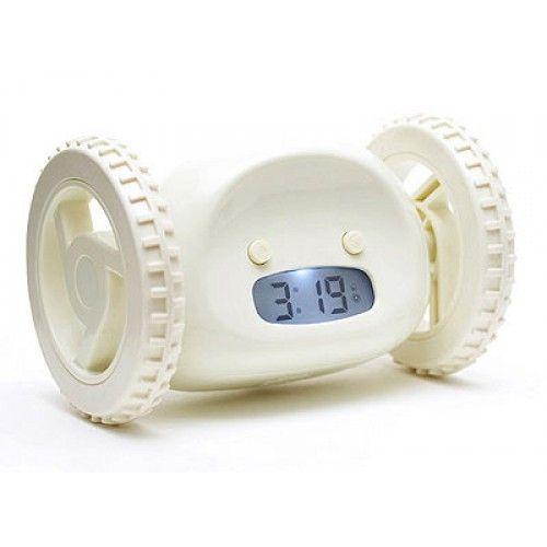 Убегающий будильник Alarm Clocky Run белыйНеобычные будильники<br>Убегающий будильник Alarm Clocky Run (белый)<br> Инструкция к убегающему будильнику Alarm Clocky Run<br><br> Вставать утром по первому звонку получается далеко не у всех. Организм не хочет просыпаться, появляется желание перевести время еще на минуточку.... А времени на утренние процедуры и сборы остается все меньше. Убегающий будильник Alarm Clocky Run поможет Вам перестать поддаваться слабостям  и переносить пробуждение. Традиционные будильники не имеют в свое распоряжение средств к защите от Вашего доступа для перестановки времени. Будильник на колесах легко ускользнет от кровати  и Вы встанете именно тогда, когда запланировали!<br><br><br><br><br> <br><br><br><br>Каким образом Вы просыпаетесь?<br><br> Будильник Alarm Clocky Run с помощью прорезиненных колес передвигается по полу, избегая препятствий, призывая Вас искать его. Когда пришло время  прибор начинает проигрывать мелодию. Если Вам хочется подремать еще какое-то время, то вы можете (предварительно включив функцию) воспользоваться крупной кнопкой Snooze. После этого будильник отключится на установленное Вами время.<br><br><br> Но он дает только один такой шанс! Как только время истекло, снова громко начинает играть сигнал, а будильник улепетывает от Вас подальше. Как бы не хотелось снова провалиться в сон, а приходится вставать и искать настырного помощника. Вы получите заряд бодрости на целый день, сонливость пропадет и немного зарядки еще никому не мешало!<br><br>Будильник можно настроить под себя!<br><br> Убегающий будильник Alarm Clocky Run  дает возможность подредактировать настройки под удобный для Вас вариант пробуждения. Возможно установить продолжительность времени, которое Вы будете дремать после первой тревоги. Диапазон регулируется от 0 до 9 минут. Установив 0, Вы лишаете себя такой возможности и аппарат начнет бегство при первом звонке.<br><br>Особенности<br><br> Будильник  наделен  достаточным интеллектом.  Встречая препятстви