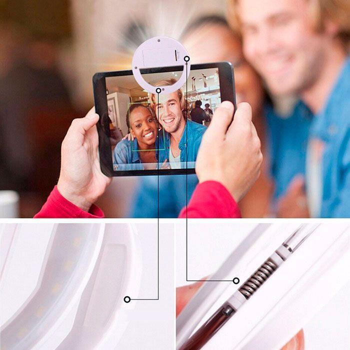 Селфи-лампа Selfie Ring Light светодиодное кольцо (от USB)Лампы для Селфи<br>Селфи-лампа Selfie Ring Light (от USB)<br> <br>Не понаслышке знаете, что сделать хорошее селфи - задача сложная? Упростить Вам ее поможет селфи-лампа Selfie Ring Light (от батареек, цвет в ассортименте)! Селфи-лампа позволяет делать фотографии и селфи высокого качества в любое время суток. Устройство оснащено 36 светодиодами и имеет 3 режима яркости подсветки: Light, Medium, Hard. Работает от встроенного аккумулятора и заряжается через USB-кабель. Селфи-лампа крепится к гаджету по принципу прищепки, не повреждая при этом экран и корпус устройства.<br>  <br>Что такое селфи-лампа?<br>  <br>Стильный аксессуар, который по достоинству оценят любители «себяшек». Компактная селфи-лампа обеспечит достаточное количество света для того, чтобы отличные селфи получались в любых условиях. <br> <br> <br>  Работа от USB<br> <br>  36 светодиодов<br> <br>  3 режима яркости подсветки<br> <br>  Крепление по принципу прищепки<br> <br> <br>Делайте идеальные снимки!<br> <br>Как пользоваться Selfie Ring Light<br> <br>Кольцо для селфи - незаменимый помощник для тех, кто связал свою профессиональную деятельность с фото и видео съемкой. Если Вы визажист, fashion-блогер, ютюбер, или просто заядлый инстаграмер - компактное селфи кольцо поднимет ваши фото на новый уровень. Мощные светодиодные лампочки обеспечат Вам студийное освещение независимо от того, где вы находитесь.<br> <br>Светодиодное селфи кольцо очень простое и удобное в применении. Все что вам нужно - это прикрепить его на ваш телефон с помощью удобной клипсы и выбрать один из трех подходящих режимов яркости. Теперь вы сможете делать отличные снимки в любое время суток и независимо от качества освещения. Будь то вечерняя прогулка, клубная вечеринка или концерт вашей любимой группы, снимки выйдут отличными.<br> <br>Преимущества светодиодного кольца<br> <br><br><br> <br> <br>  Экономичность. Благодаря новым LED светодиодам вы сможете не переживать о запасе эн