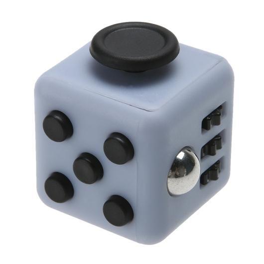 Кубик-антистресс Fidget Cube (Фиджет Куб)Кубики Антистресс Fidget Cube<br><br> Каждый человек хотя бы раз в жизни испытывал состояние напряжения и бесконтрольной двигательной активности. Вы тоже клацаете ручкой на важном совещании или «хрустите» пальцами в стрессовые моменты? Fidget Cube — и ваше поведение перестанет раздражать окружающих. Это замечательное приспособление как раз создано для того, чтобы расслабиться в сложные моменты или сосредоточить внимание, когда это необходимо. Кубик  имеет миниатюрные размеры и не займет много места в вашем кармане.<br><br><br>  <br><br>Кому нужен такой кубик?<br><br> Давно известно, что тренировка мелкой моторики рук способствует развитию головного мозга как у детей, так и у взрослых. Но если малыши могут удовлетворить эту природную потребность, играя с мелкими игрушками или перебирая пуговицы, то у взрослых дела обстоят сложнее.<br><br><br>Fidget Cube просто создан для тех, кто:<br><br><br>регулярно грызет колпачки ручек и карандаши;<br>«клацает» кнопочными ручками;<br>звенит монетками в кармане;<br>дергает ногой или «хрустит» пальцами;<br>постоянно вертит в руках небольшие предметы;<br>производит любые другие неконтролируемые манипуляции, раздражающие окружающих.<br><br><br> По отзывам тех, кто уже испробовал на себе это замечательное устройство, кубик моментально успокаивает после сильного стресса и помогает сосредоточиться в момент принятия важного решения.<br><br><br> Еще один немаловажный момент заключается в том, что Fidget Cube стоит дешево. Его цена по карману даже самому отчаянному скряге.<br><br><br>  <br><br>Что такое Fidget Cube<br><br> Кубик имеет 6 сторон. Каждая из них оснащена специальными роликами, кнопками, выемками, джойстиками или шариками. Взяв его в руки один раз, вы больше не захотите с ним расставаться!<br><br><br>Любите щелкать пальцами? Крутите! Особый подвижный диск, расположенный на одной из сторон, поможет принять правильное решение. Двадцать – тридцать оборотов и все получиться!<br>Прекратите ло